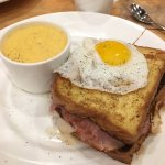 Croque madam with cheesy grits