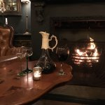 A carafe of red wine by the fire at Mademoiselle's! Cozy.
