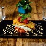 Zeebaarsfilet op zuurdesem met tomatencouscous, serranoham en knoflookmayonaise