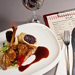 Confit goose leg with jerusalem artichoke purée and braised red cabbage strudel