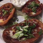 Where's the cheese and bacon? Soggy, deep fried potato skins with unexpected BBQ sauce.