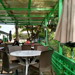 Breakfast view- partially under trees and partially covered