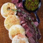 Sirloin steak with arepas and chimichurri
