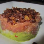 Appetizer of tuna tartare with guacamole and fried shallots