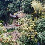 Pagoda on mountain side. Waterfall underneath