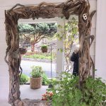 Beautiful driftwood mirror at the front entrance