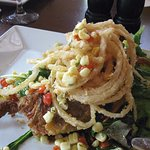 Soft Skin Crab over salad and under onion rings