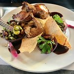 Pigeon done pink with good demiglase, a little legume and mushroom salad and tiuiles.