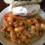 Seafood jambalaya with baked potato