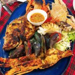 Seafood basket (L) which cost $1,980 thai baht