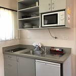 One Bedroom Unit kitchen with cooking elements, fridge, microwave and sink