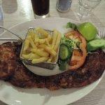 Pork chop, fries, salad