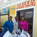 Mama Zoliswa from Isiseko Educare receiving some warm blankets