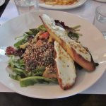 Quinoa and roasted vegetable salad with goat cheese on toast