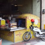 Their brick oven and delivery motorbike.