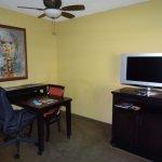 TV & desk in sitting area.