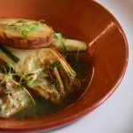 Artichoke Guazzetti, featuring a fragrant sun choke broth and topped with roasted potatoes.
