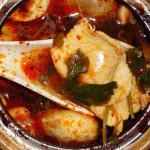 Tom Yum soup. A hot and sour type of Thai soup.  Very warmiing.