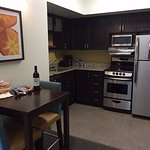 full size kitchen with pots, pans, utensils, etc..