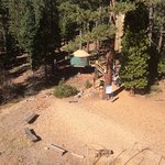 view of the headquarters yurt, from the highest point in the flying squirrel courses