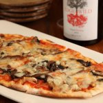 Half priced flatbreads and appetizers during happy hour.