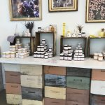 Bee hives make up the display table, charming recycle job