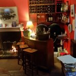 Here's the bar at the Old Fire Engine House. Note the little warm fire in the fireplace. Good pl