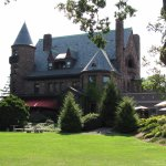 Castle from back lawn; Edgar's Restaurant under red awning; Stonecutters patio on right.