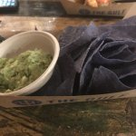 Fresh guacamole with blue corn chips and chipotle chicken tacos! What a treat!