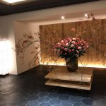 The entryway had a stunning arrangement of flowers.