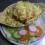 A range of Jacket potatoes with salad garnish