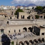 Port area in foreground and Vesuvius in background at Herculaneum