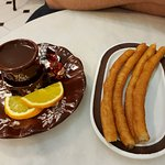 Churros with orange chocolate