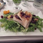 Warm chicken over salad with cranberries and oranges