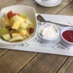 Fresh fruit salad with yogurt and raspberry coulis