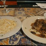 Veal Marsala and pasta with Alfredo on it. First bite of each was delicious.