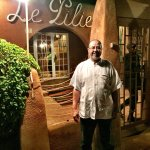 The security guard in front of Le Pilier Restaurant to check each customer before entering the R