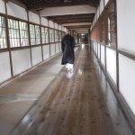 Monk going between buildings on special walk