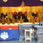 Large ceremony with many monks .