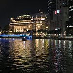 Hotel at night from walkway along the Singapore River