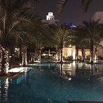 The stunning oasis like pool at night.