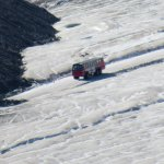 Four wheel bus on glacier
