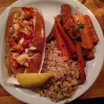 Hot lobster roll, rice pilaf and roasted carrots.