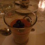 a half filled shooter glass of panna cotta was my dessert