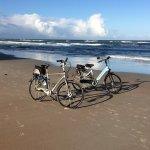 ride bikes along the beach