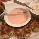 Entrees from last night's dinner: pecan crusted triplefin and crab cakes.