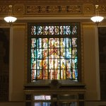 The lobby has a stained glass window that depicts the Catheral of San Fernando