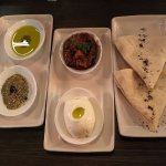 Stage 1: house baked bread, Labneh, dukkah, extra virgin olive oil, and eggplant & tomato ragout