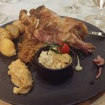 Knuckle of pork with fried cabbage and potatoes, must try.