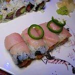 Jalapeño Roll (Spicy tuna wrap in soy paper top with white tuna, jalapeño, tobiko & tomato)